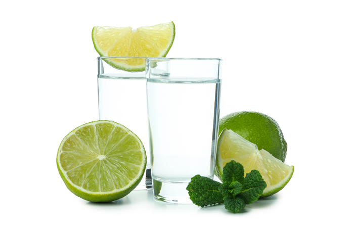 gin and tonic with limes cut open around the glasses