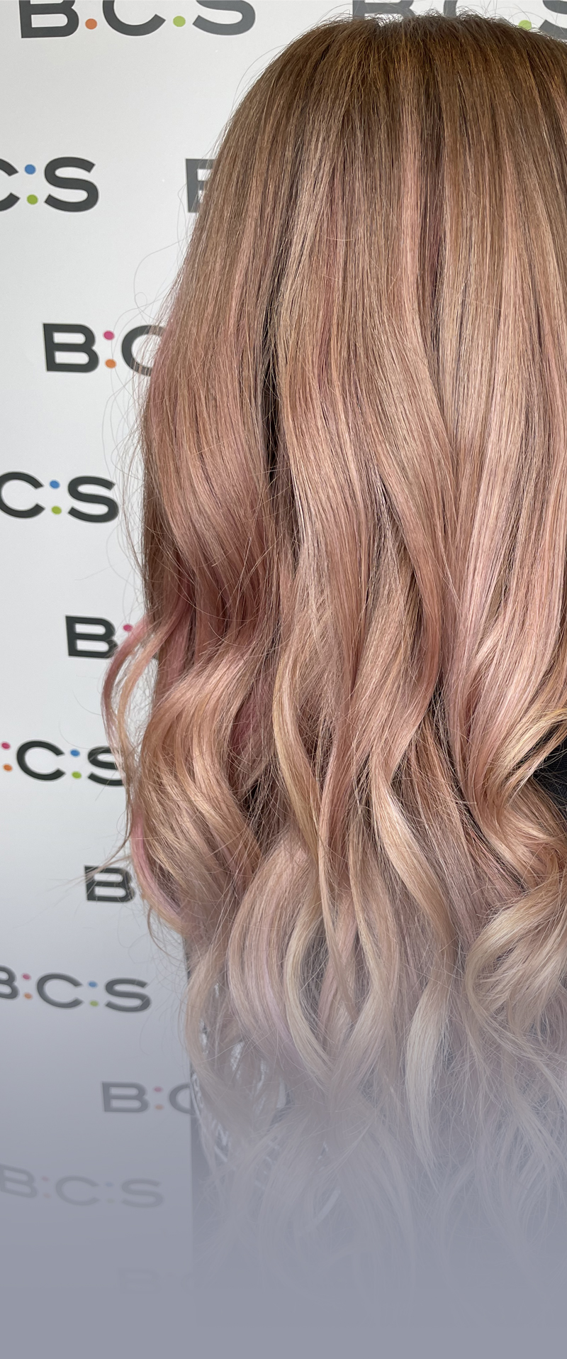 curled hair with BCS banner behind. profile shot of hair
